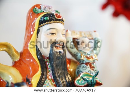 A picture of Fu, chinese God of wealth. taken with a clear shot at his face at a public place.