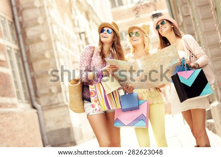 A picture of group of tourists using map in the city - stock photo