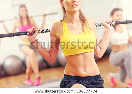 A picture of group women working out in gym - stock photo
