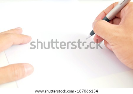 A picture of holding pen with white paper - stock photo