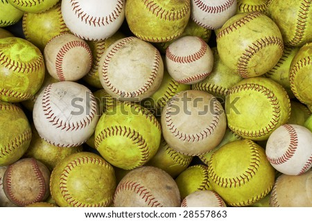a picture of old softballs and baseballs - stock photo