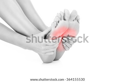 A picture of painful female feet over white background - stock photo