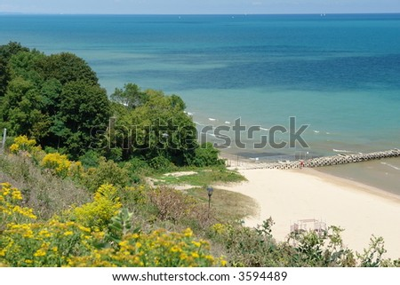 A picture of the lake front viewed from a hill - stock photo