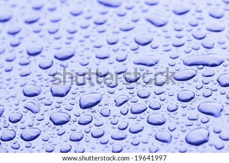a picture of water drops on metal surface - stock photo