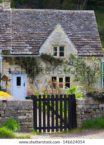 A picturesque, historic cottage in the Cotswolds tourist destination of Bibury, Gloucestershire, UK.