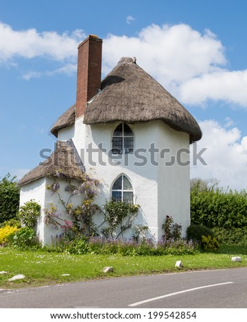 A picturesque white, thatched cottage at Stanton Drew, Somerset, UK.