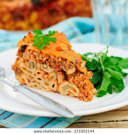 A Piece of Bolognese Pasta Bake, Macaroni Cheese, Minced Meat and Pasta Pie, square - stock photo