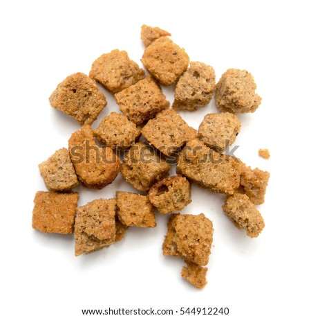 a piece of brown bread biscuit on a white background