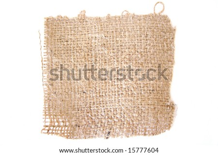 A piece of burlap isolated on a white background. - stock photo