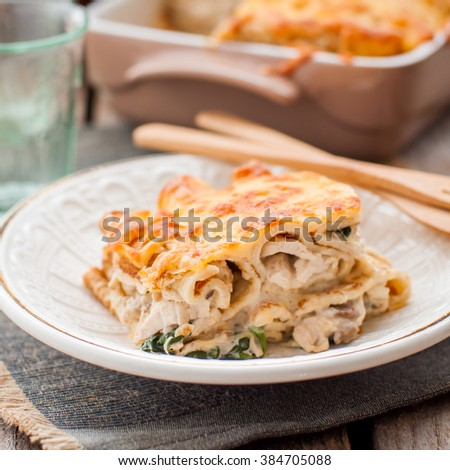 A Piece of Cheese Crusted Crepe Bake, square - stock photo