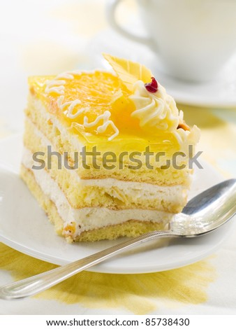 A piece of cheese torte on a plate. Selective focus