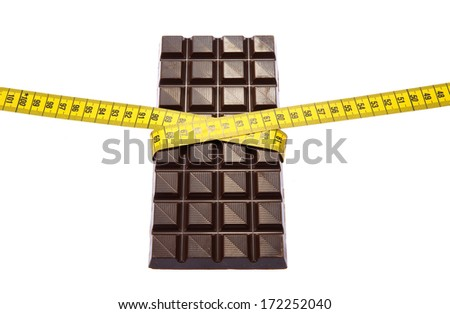 A piece of chocolate with measuring tape around it - stock photo