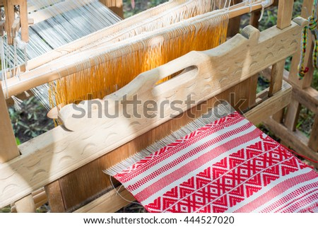 a piece of cloth with a small depth of field woven in a loom - stock photo
