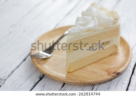 a piece of coconut cake on dish. - stock photo