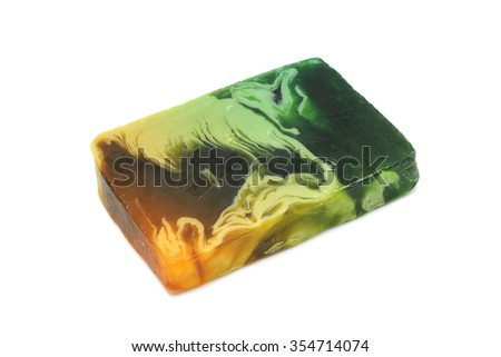 a piece of colored handmade soap on a white background