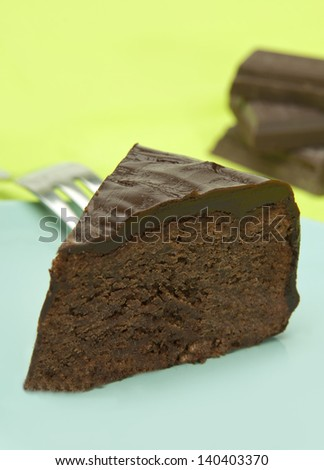a piece of double chocolate cake on a plate - stock photo