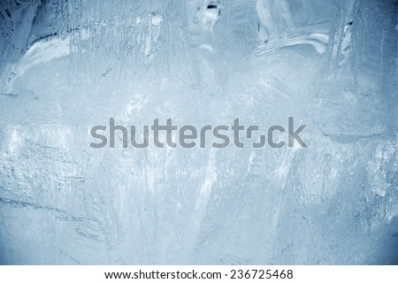 A piece of ice back lit. Close-up. - stock photo