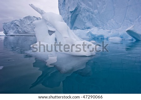 a piece of ice sculptured by the wind and water in east greenland - stock photo