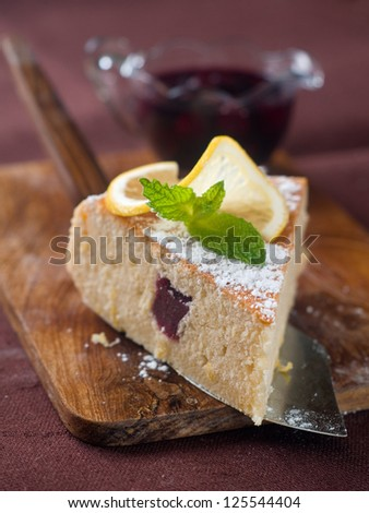 A piece of lemon cake with mint decoration, selective focus, shallow DOF - stock photo