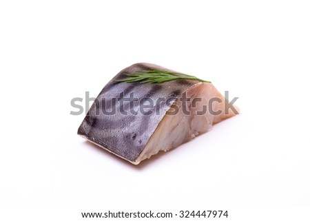 a piece of mackerel with dill isolated