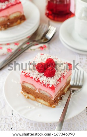 A Piece of No Bake Layer Cake (Savoiardi Soaked in Raspberry Liqueur, Chocolate Mousse, Raspberry Mousse and Raspberry Jelly), copy space for your text - stock photo