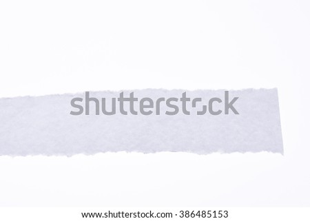 a piece of white blank torn note paper