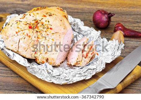 A Piece Turkey in Spices for Grilling on Woody Background Studio Photo - stock photo