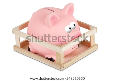 A Piggy bank in small wooden corral - stock photo