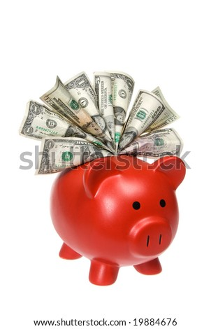 A piggy bank stuffed with cash isolated on a white background.