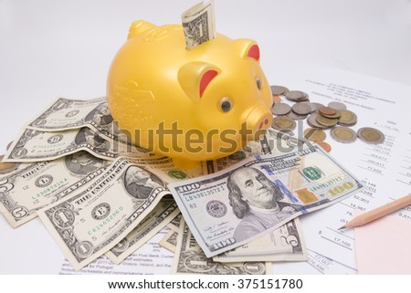 A piggy bank with money dollars , savings.Chinese language on piggy is gold and money Ood. - stock photo