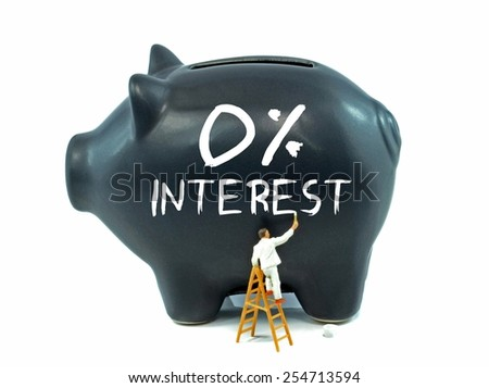 A piggy bank with zero percent interest theme painted on the side on a white background