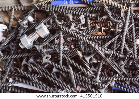 A pile fasteners, hardware Screws for fastening parts from different materials, primarily wood, to one another.