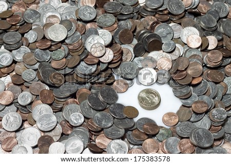A pile of American coins with gold dollar coins - stock photo