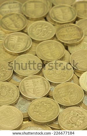 A pile of Bank of england One pound Coins - stock photo