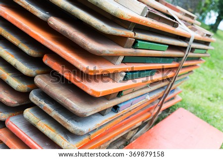 a pile of benches, for festival or beer garden - stock photo