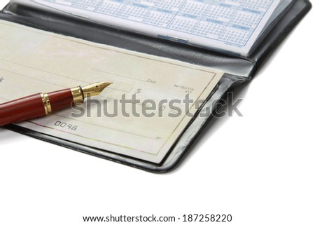 A pile of bills, checkbook, pen on the table. - stock photo