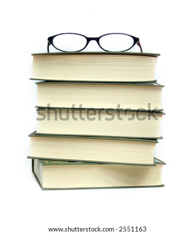 a pile of books and eyeglasses