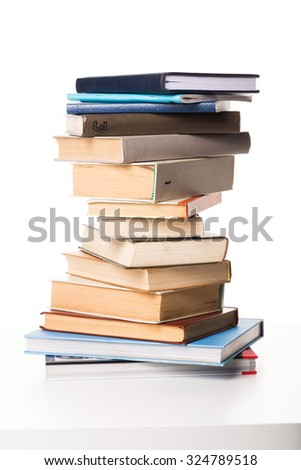 A pile of books on white background - stock photo