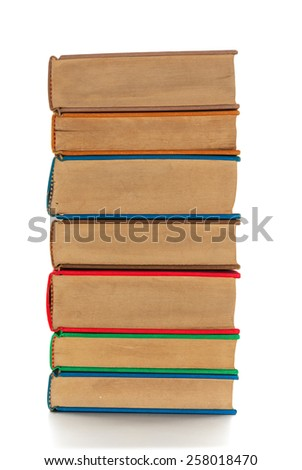 A pile of books with colored covers view from the side