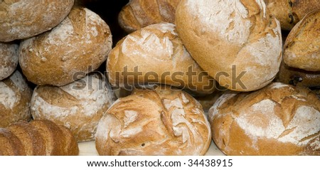 A pile of bread loaves for sale