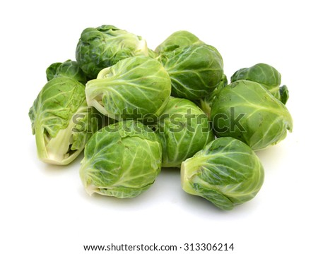 a pile of Brussels sprouts on a white background - stock photo