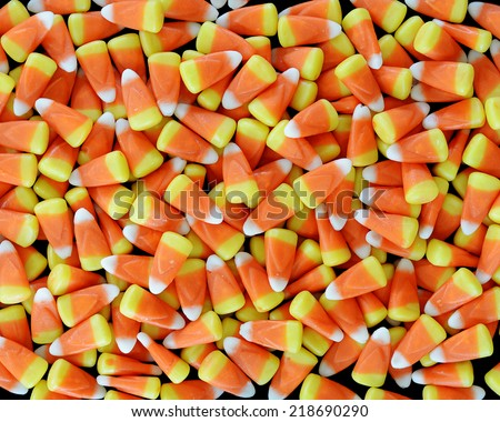 A Pile of Candy Corn on a Black Background - stock photo