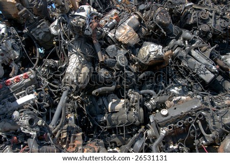 A pile of car engines for recycling - stock photo