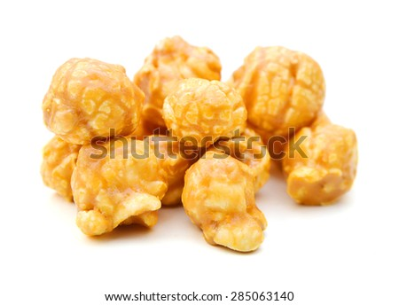a pile of caramel corn on a white background  - stock photo