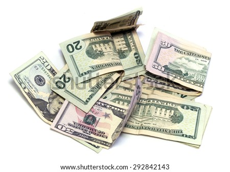 A pile of cash, American dollars in twenties and fifties on white, not isolated.