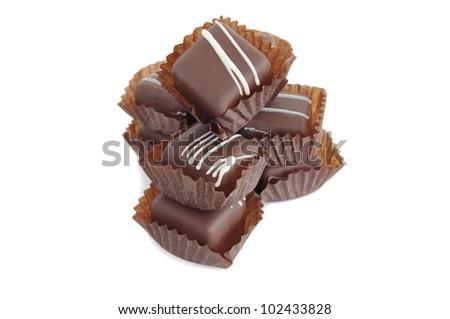 a pile of chocolates on white backroung - stock photo