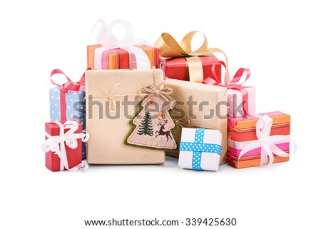 A pile of Christmas gifts isolated on white background. - stock photo