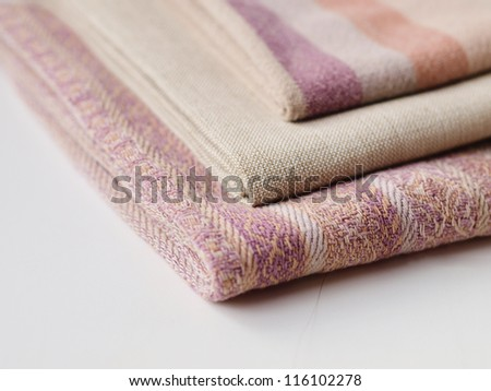 A pile of cloths of different texture - stock photo