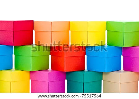 A pile of colorful boxes isolated on white. - stock photo