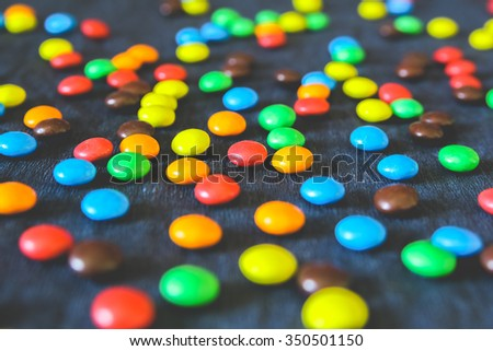 A pile of colorful chocolate coated candy - stock photo
